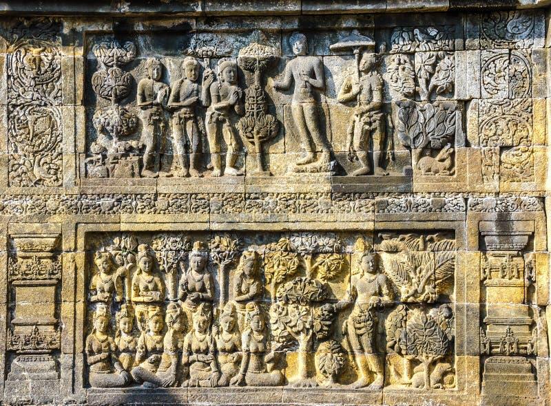Pietra decorata con i bassorilievi nel tempio di Borobudur in Yogy immagine stock libera da diritti