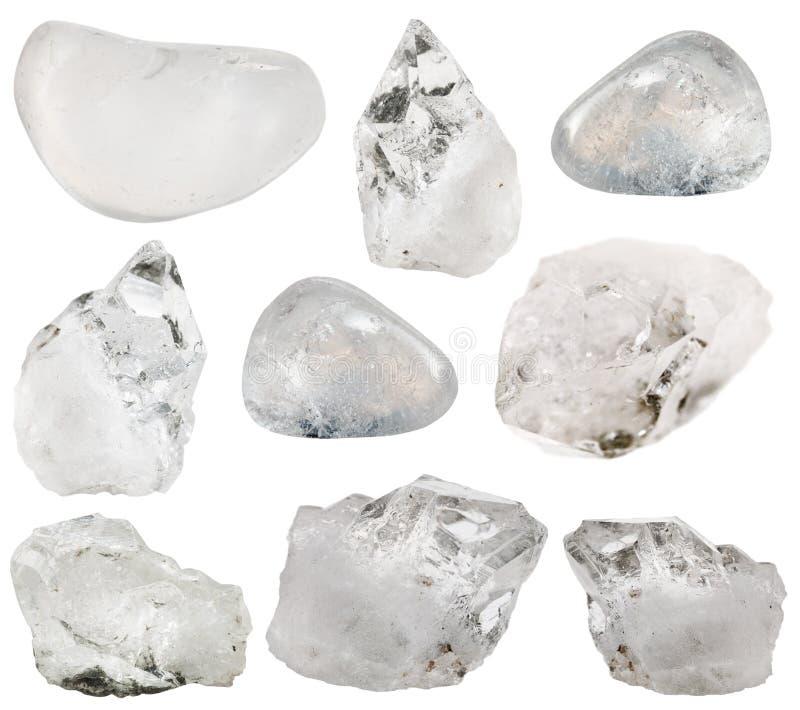 Pietra del cristallo di rocca (chiaro quarzo) e gemme ruzzolate fotografia stock libera da diritti