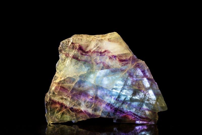 Pietra minerale della fluorite con fondo nero fotografia stock