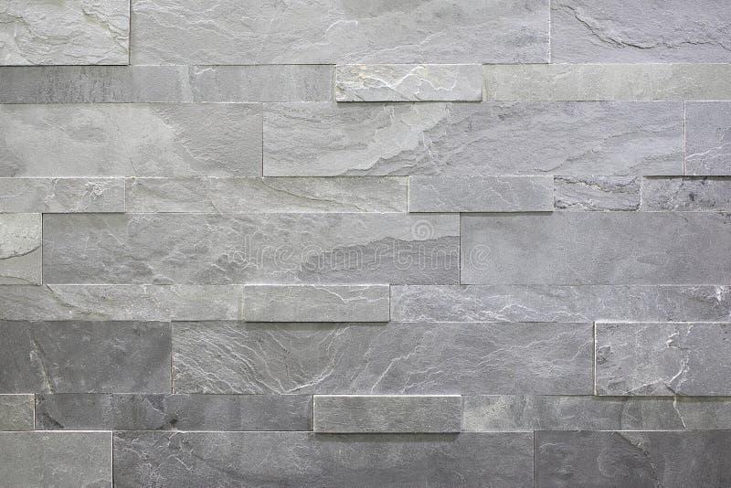 Pietra naturale, muratura lineare liscia, struttura grigia di sollievo La parete ? fatta della pietra, la superficie ? strutturat immagini stock