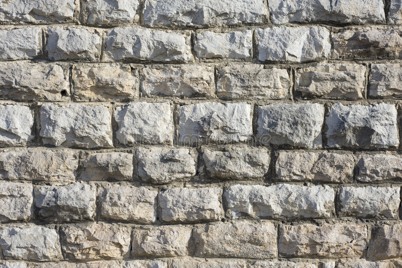 Pietra o muro di mattoni della massoneria immagine stock