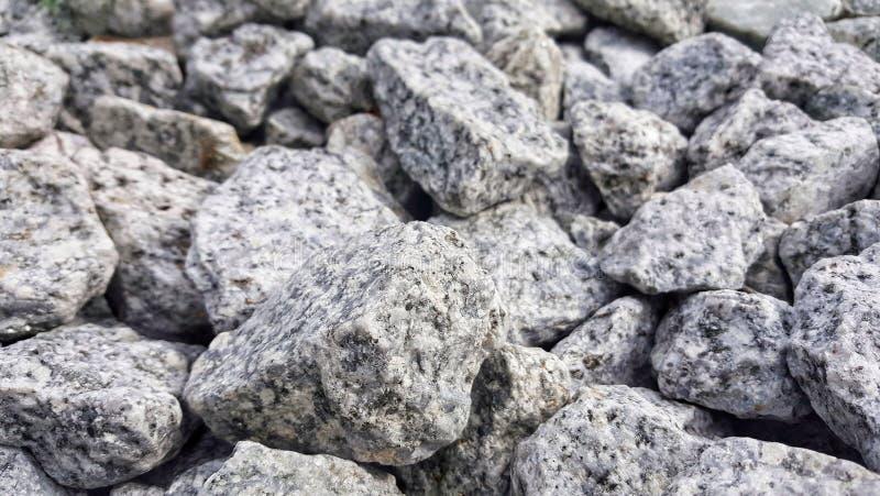 Pietra rotonda usata per riguardare i fondi stradali struttura di pietra, immagine stock libera da diritti