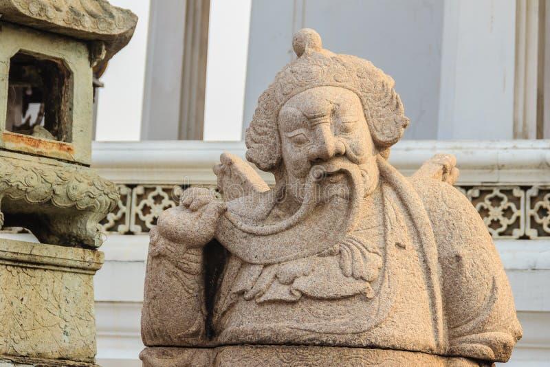 Pietra sveglia della statua cinese di arti in Wat Suthat Temple, Bangkok, fotografia stock libera da diritti