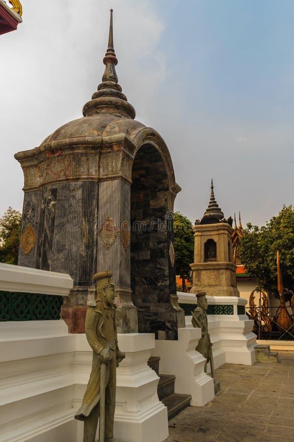 Pietra sveglia della statua cinese di arti in Wat Suthat Temple, Bangkok, immagini stock libere da diritti