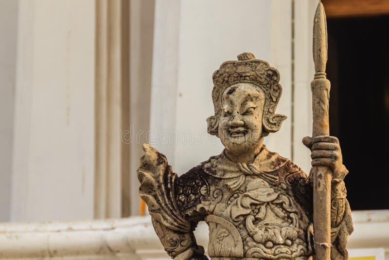 Pietra sveglia della statua cinese di arti in Wat Suthat Temple, Bangkok, immagine stock