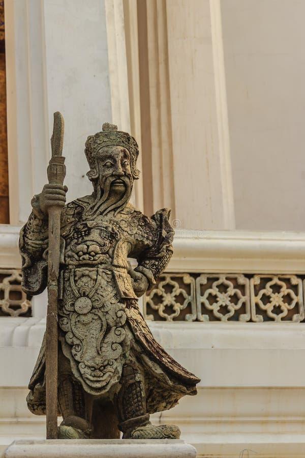 Pietra sveglia della statua cinese di arti in Wat Suthat Temple, Bangkok, fotografia stock