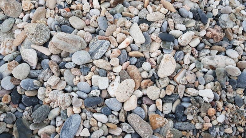 Pietre della spiaggia per la carta da parati fotografia stock libera da diritti