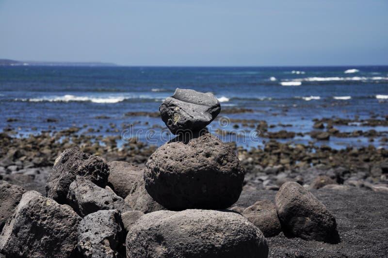 Pietre sul Playa de Janubio a Lanzarote, isole Canarie, stazione termale fotografie stock libere da diritti