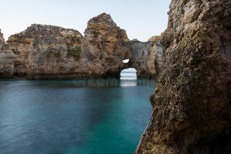 Piety`s Point is a rock formation along the coastline of Lagos, in Algarve, Portugal stock photography
