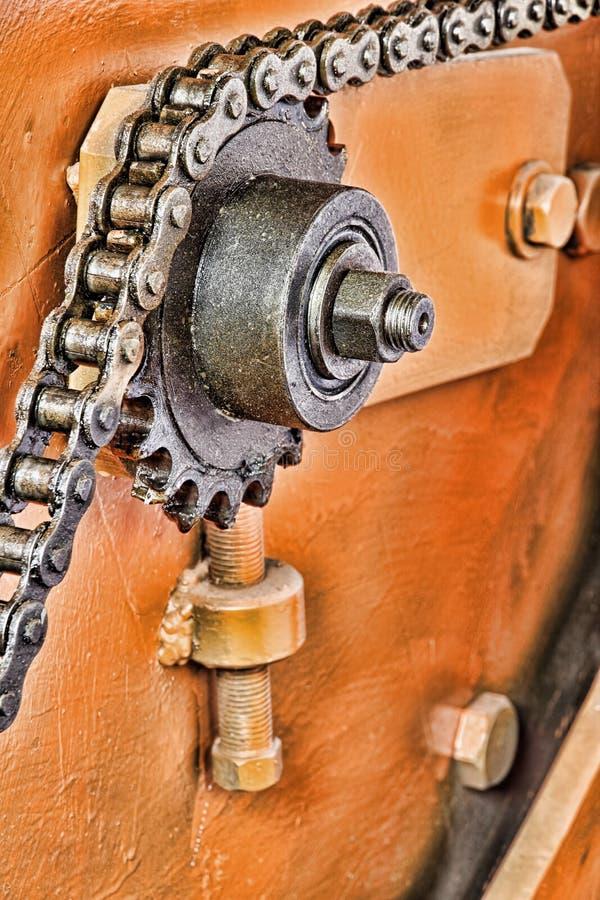 Pieza de la máquina Primer tomado cadena de la rueda dentada y del metal imágenes de archivo libres de regalías