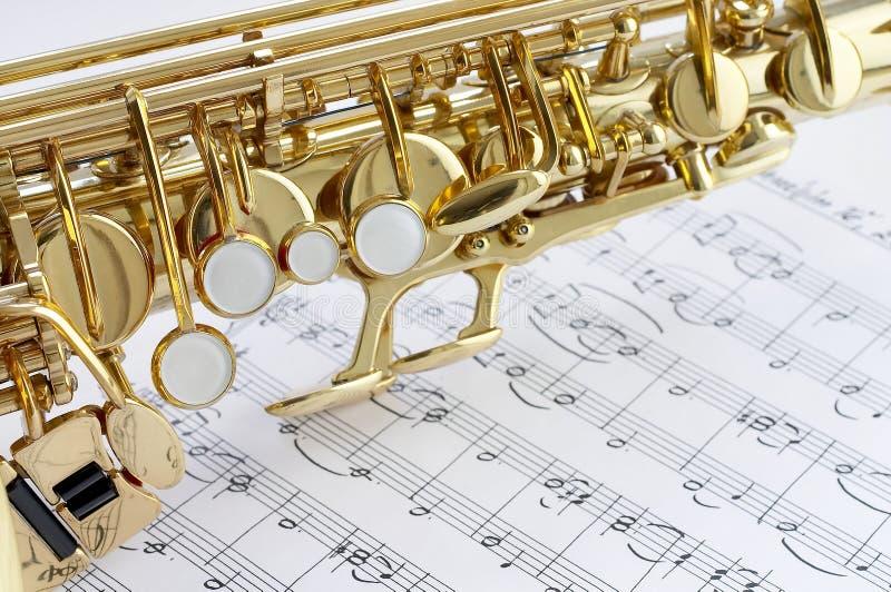 Pieza del saxofón y de la nota imagen de archivo libre de regalías