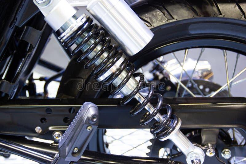 Pieza negra de los amortiguadores de choque de la motocicleta fotografía de archivo