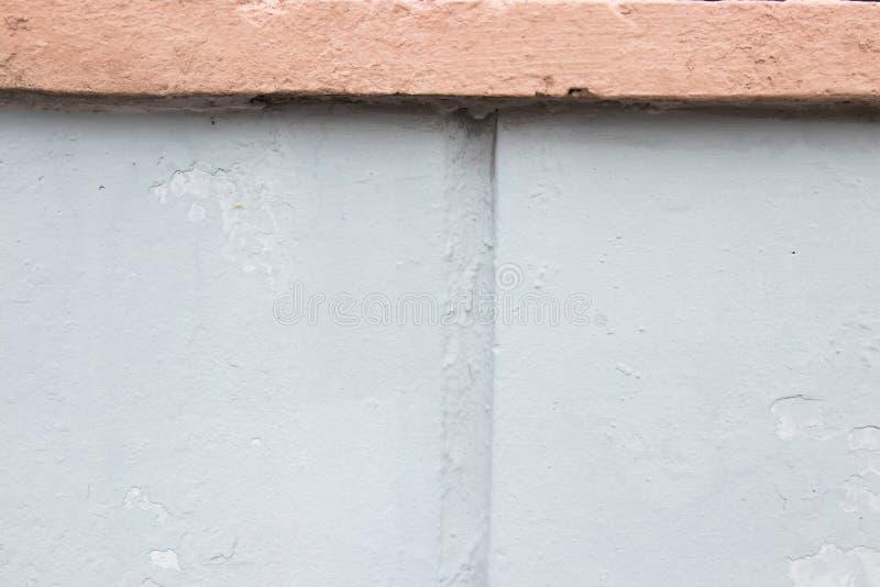 Piezas azules rosadas y en colores pastel en colores pastel de la pared Fondo para el dise?o Lugar para el texto imágenes de archivo libres de regalías