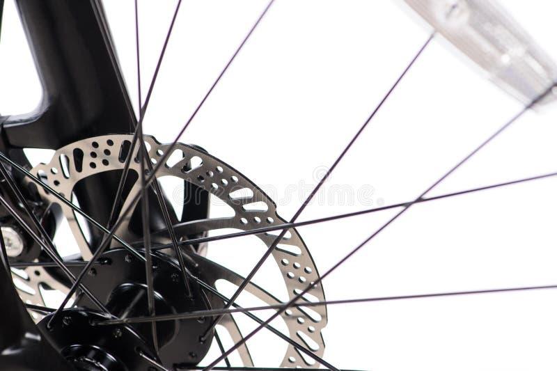 Piezas de la bicicleta amarilla en un fondo blanco del estudio Ci?rrese encima de los detalles fotos de archivo libres de regalías