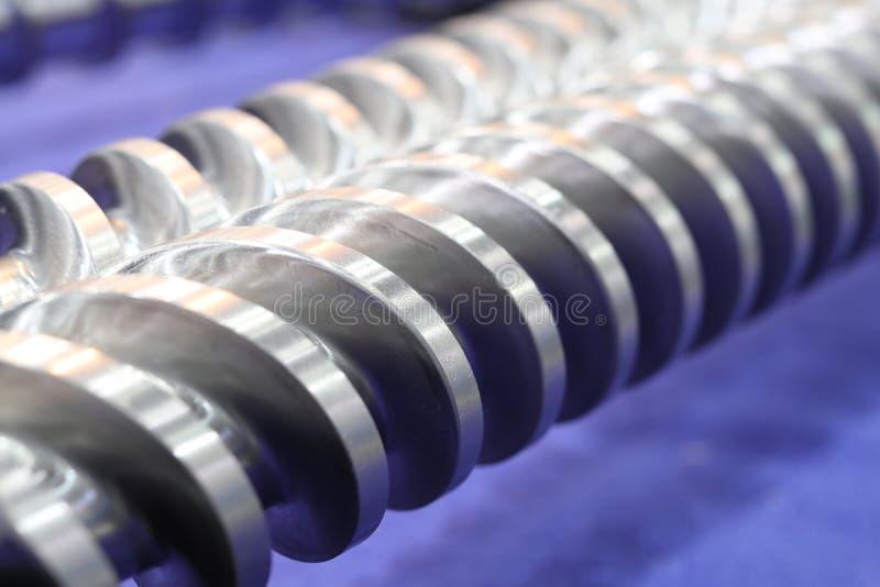 Piezas de la prensa de tornillo para la máquina plástica de la inyección imágenes de archivo libres de regalías
