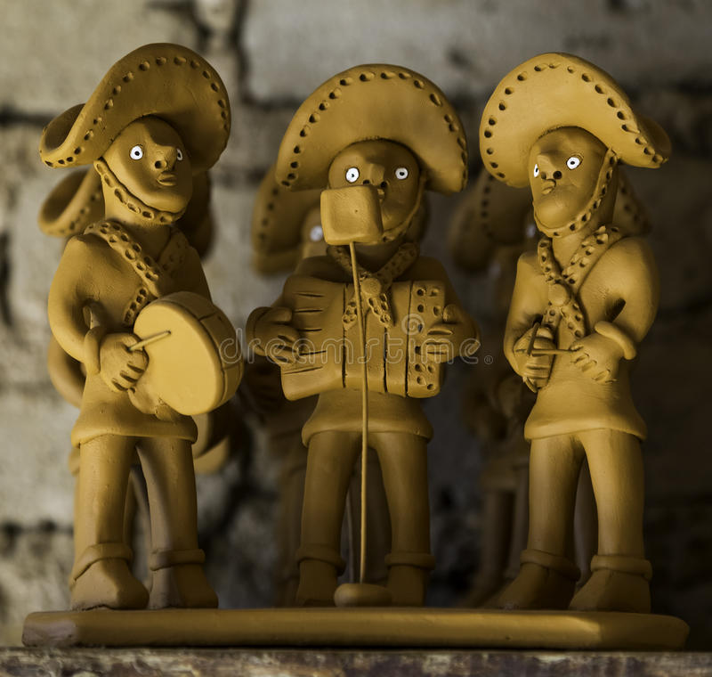 Pifanos Band. Typical clay sculpture representing a pifanos band very common in the northeast of Brazil used as decoration in the houses royalty free stock image