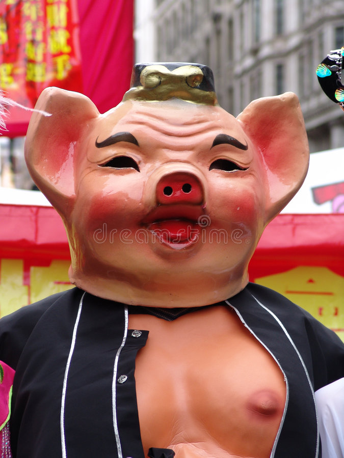 Pig at Chinese New Year. Pig costume and mask at Chinese New Year Parade in London on Yeay of the Pig stock images