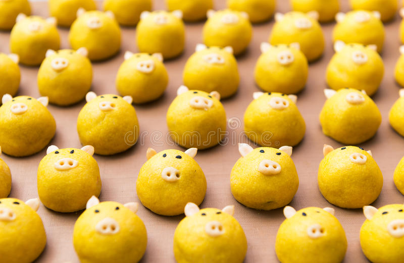 Pig cookie. Cute yellow pig cookie on tray royalty free stock image