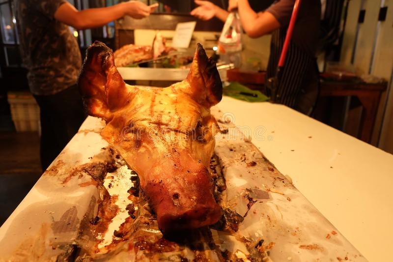 Pig head was cooked for sale at the market stock image