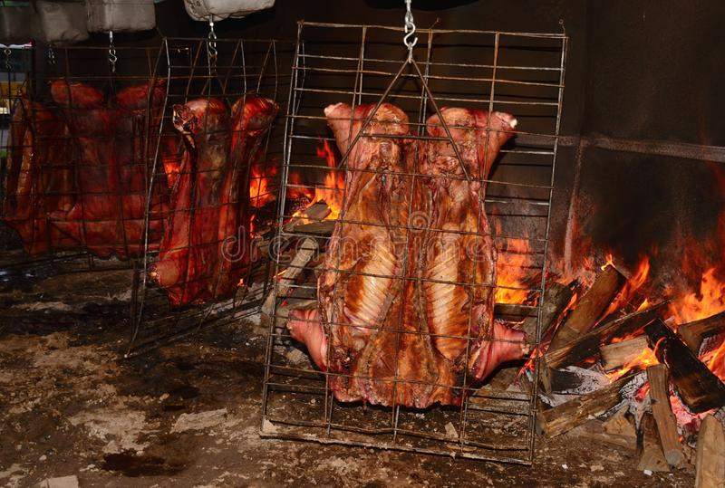 Pig Roast. Open pit fire is a common way of roasting oo a pig in certain area of Cajun Country royalty free stock photos