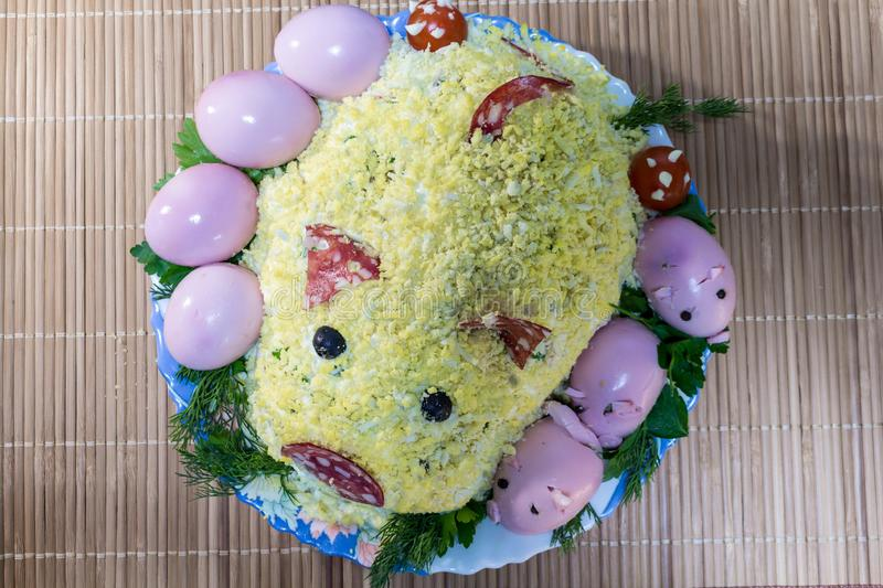 Pig salad with piglets from eggs, sausage, olives and mayonnaise royalty free stock photo