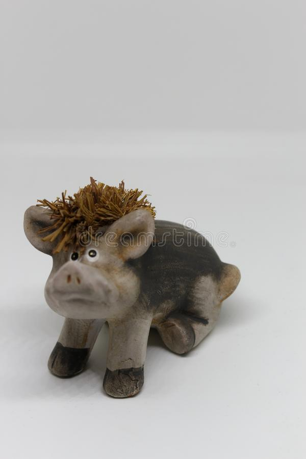 Pig with straw hair. Ceramic, Isolated stock images