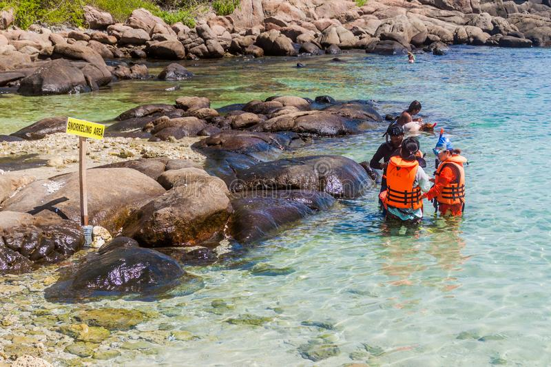 PIGEON ISLAND, SRI LANKA - JULY 25, 2016: People go snorkel on a coral reef in Pigeon Island National Park near Nilaveli. Village in Sri Lanka royalty free stock photo