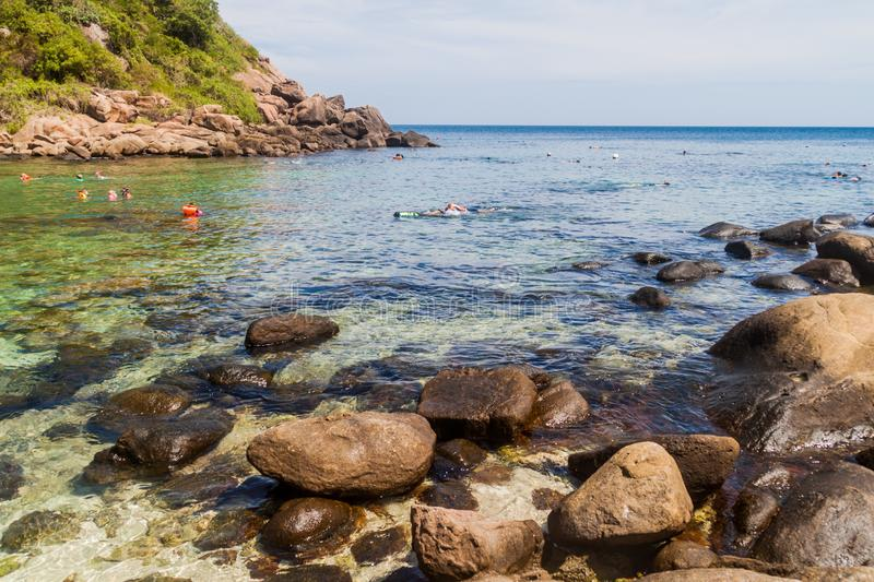 PIGEON ISLAND, SRI LANKA - JULY 25, 2016: People snorkel on a coral reef in Pigeon Island National Park near Nilaveli. Village in Sri Lanka royalty free stock images