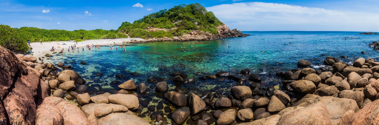 PIGEON ISLAND, SRI LANKA - JULY 25, 2016: People snorkel on a coral reef in Pigeon Island National Park near Nilaveli. Village in Sri Lanka stock image