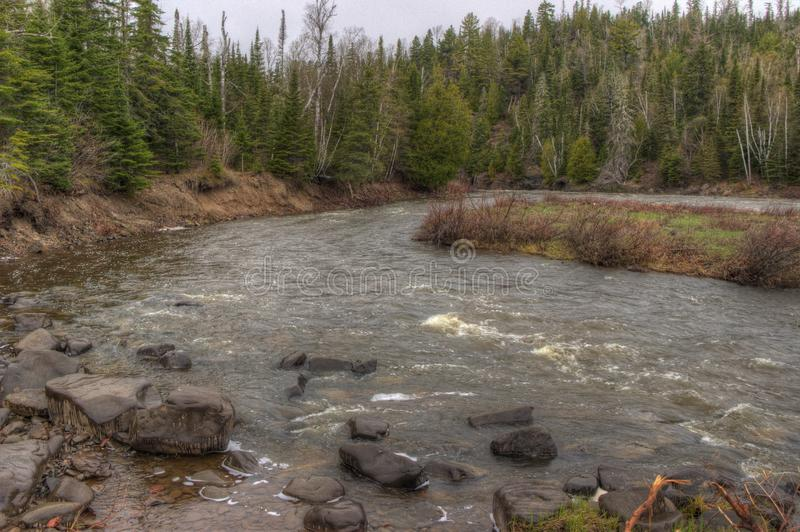 The Pigeon River flows through Grand Portage State Park and Indian Reservation. It is the Border between Ontario and Minnesota.  royalty free stock photo