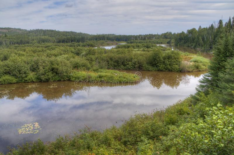 The Pigeon River flows through Grand Portage State Park and Indian Reservation. It is the Border between Ontario and Minnesota.  stock photo