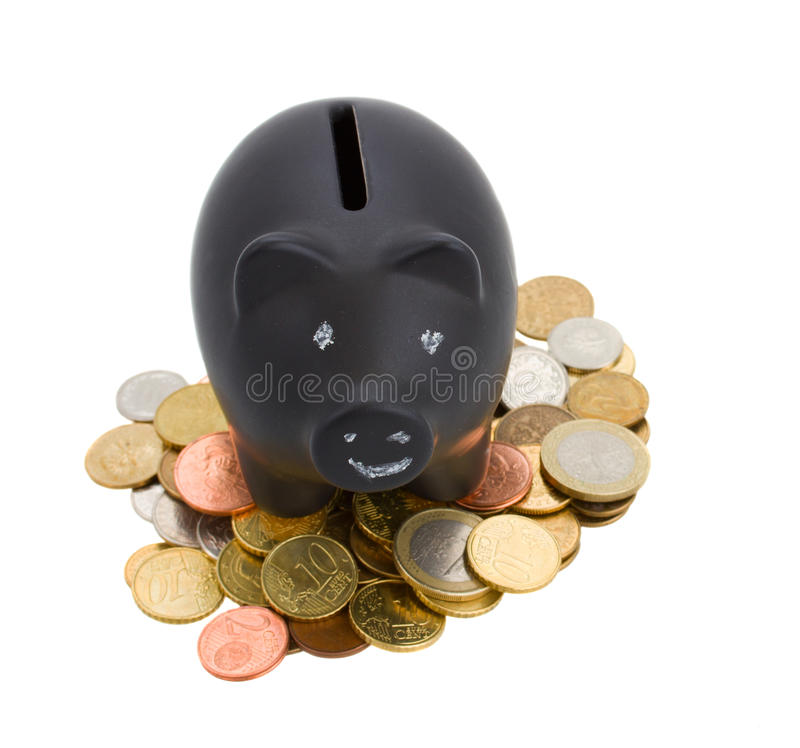 Piggey bank with cions. Isolated on white background royalty free stock photo