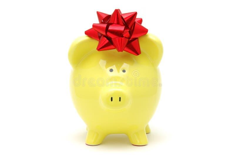 Download Piggy κίτρινος τόξων τραπεζών Στοκ Εικόνες - εικόνα από χοίρος, απομονωμένος: 1527170