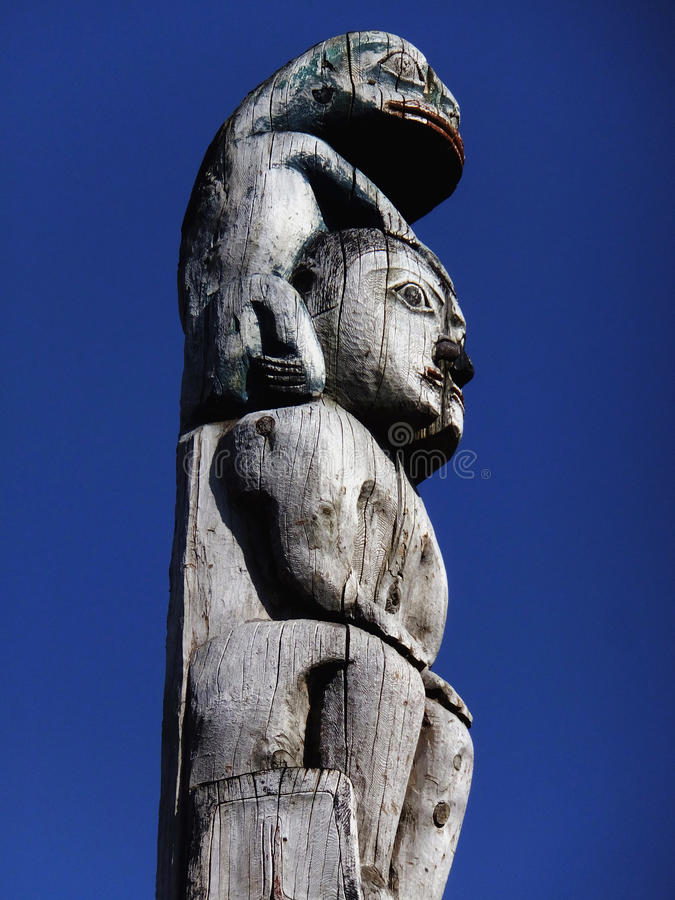 Piggy Back. Portion of totem pole at the State of Alaska Capitol Building in Juneau. With carvings honoring the Raven and Eagle clans of the Aak�w Kw� royalty free stock photos