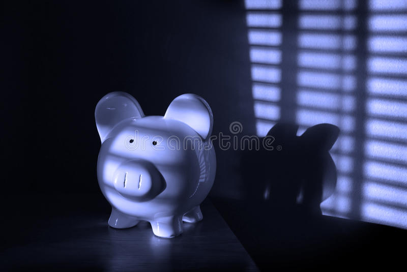 Piggy Bank. With light from blinds in background stock image