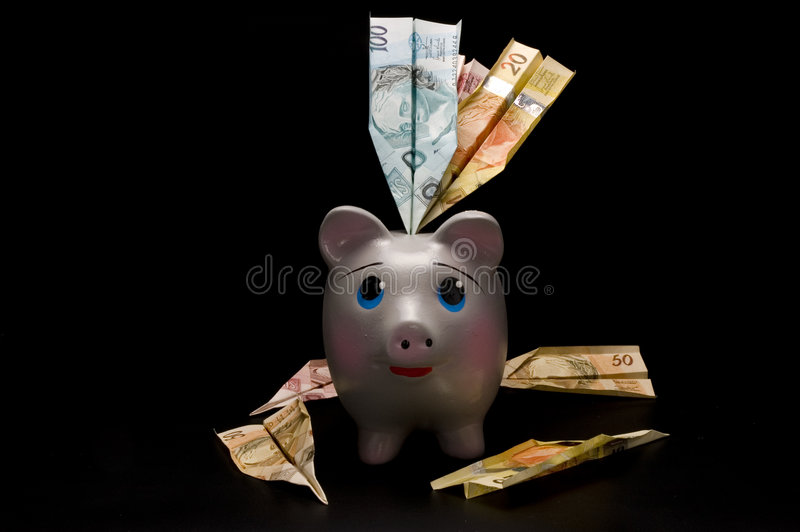 Piggy Bank. With money airplane stock images
