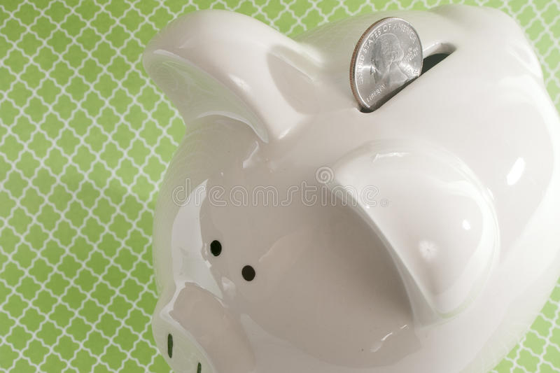 Download Piggy Bank Against Green Background Stock Images - Image: 34284084