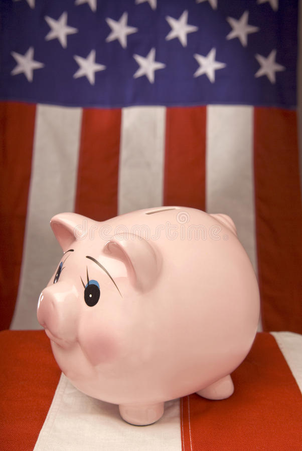 Piggy Bank With American Flag Background stock image
