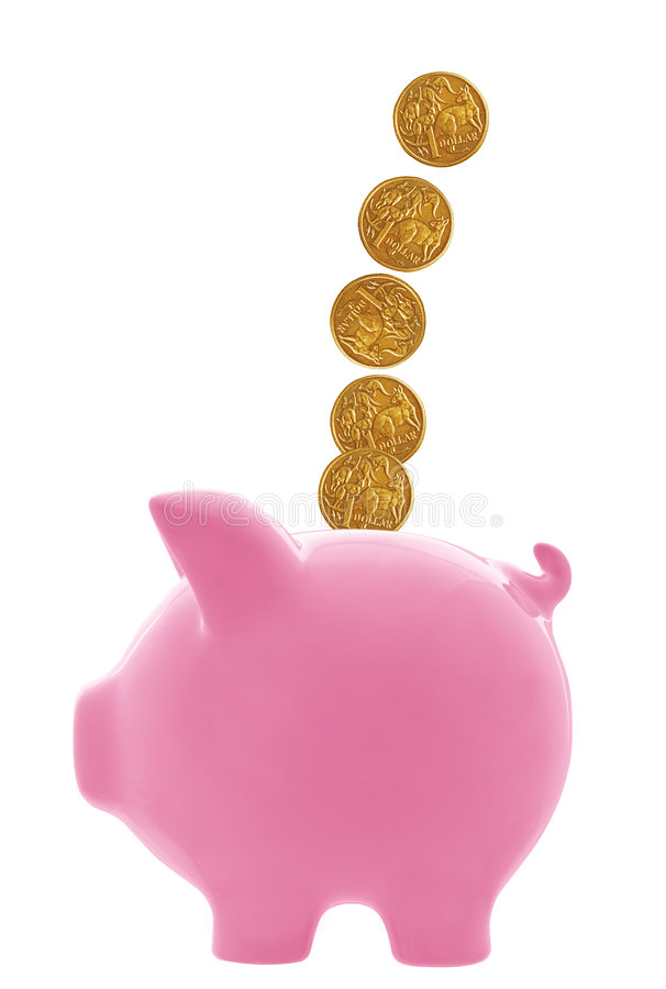 Piggy Bank with Australian Dollars. Australian dollar coins cascading into pink piggy bank. Isolated on white stock photos