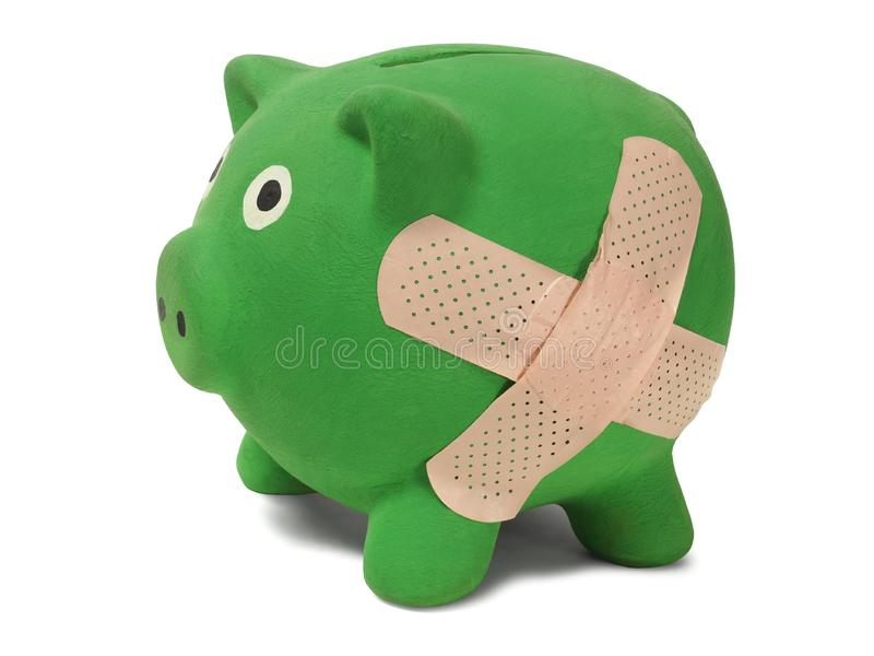 Piggy bank with band-aid royalty free stock photography