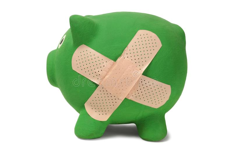 Piggy bank with band-aid stock image