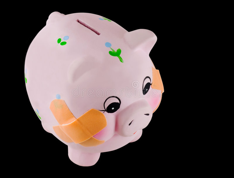 Piggy Bank with Bandages. Pink Piggy Bank with Bandages or Bandaids on cheeks stock photography