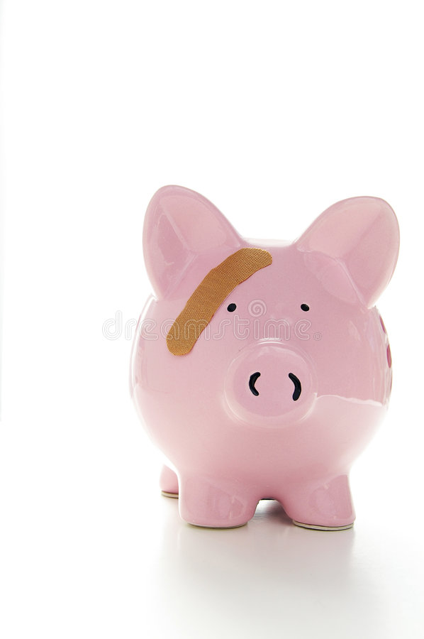 Piggy bank and bandaid stock images