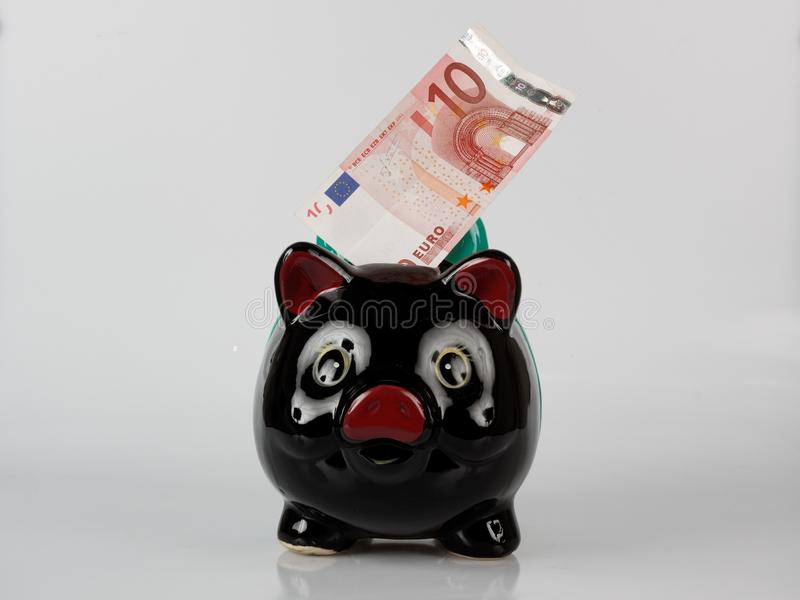 Download Piggy bank with bank note stock photo. Image of note - 11721920