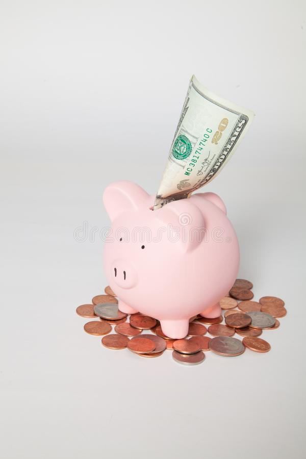 Piggy Bank with $20 sticking out royalty free stock image