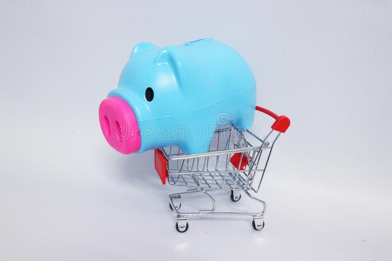 Piggy bank, blue pig, shopping cart Isolated white background. Piggy bank blue shopping cart isolated white background stock photography