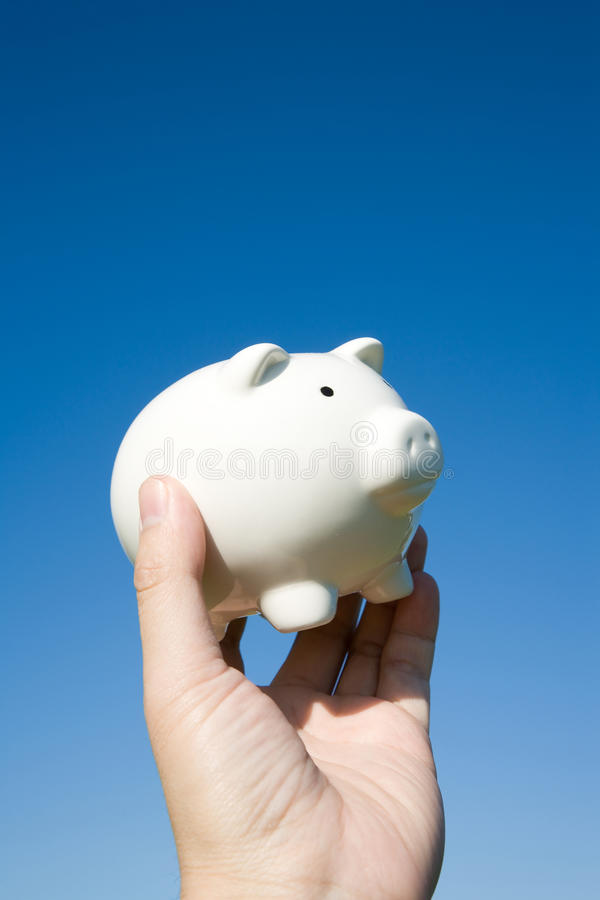 Piggy Bank and blue sky. Concept of financial success royalty free stock images