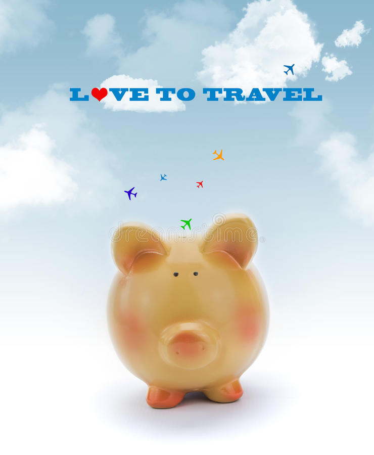 Piggy bank with blue sky and jets. Flying above royalty free stock photo