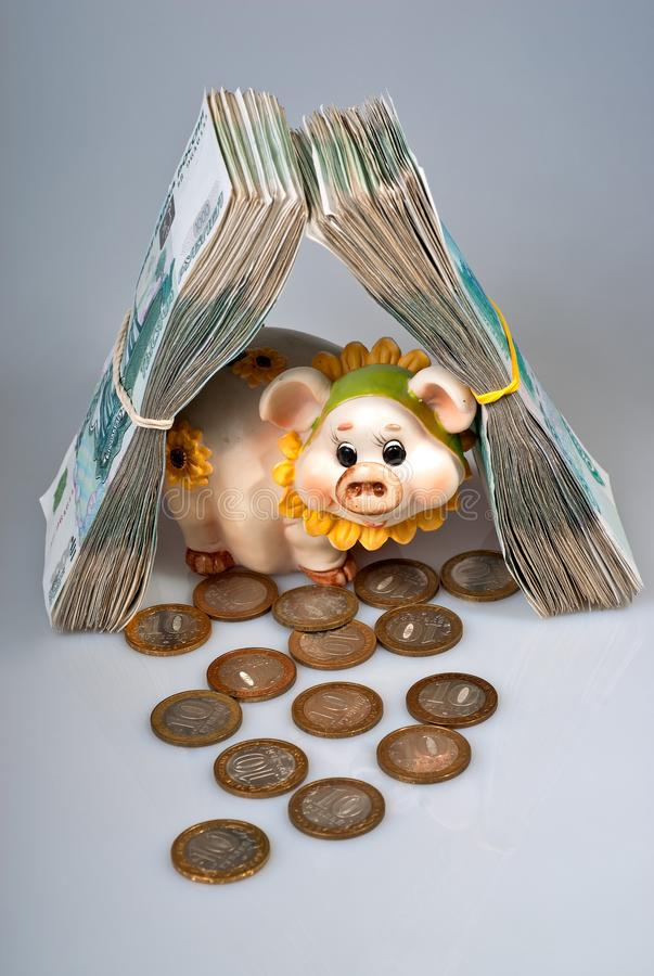 Piggy bank and bunch of russian rubles banknotes as real estate stock photos