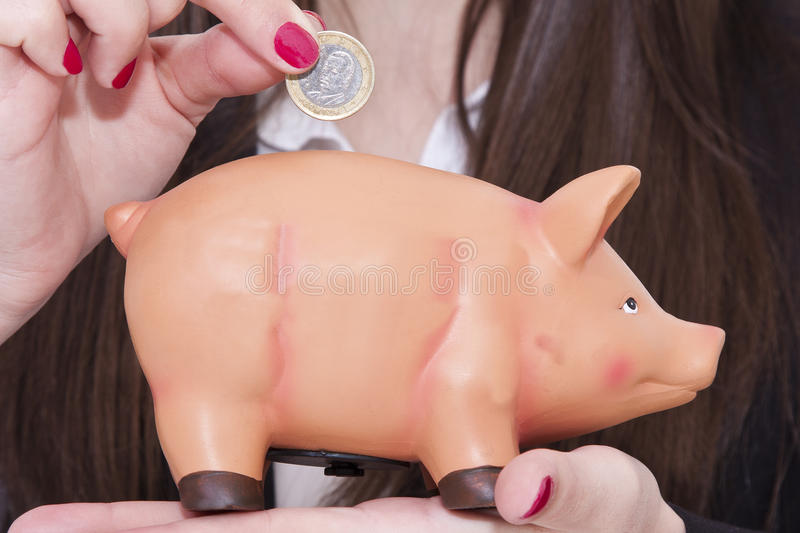 Piggy bank. Business woman with piggy bank stock photography